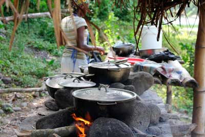 Jamaican woman cooking in the beach